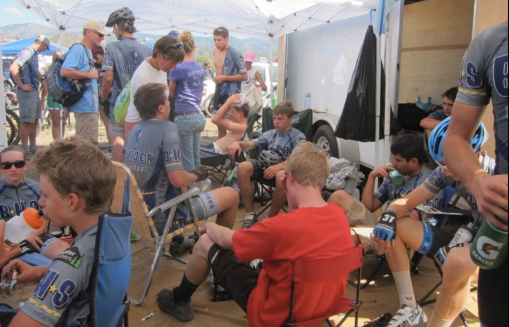 Boulder High MTB Race Team lounging in their silky jerseys