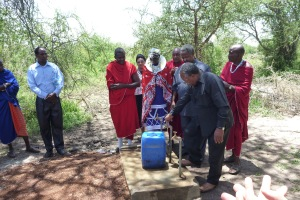 The Tribe Elder showing off the super clean water