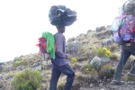 The porters prefer to carry heavy loads on their heads. Amazingly, able to balance the load with nohands!