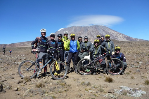 The Kili biking crew posing with Kilimanjaro summit in the background.