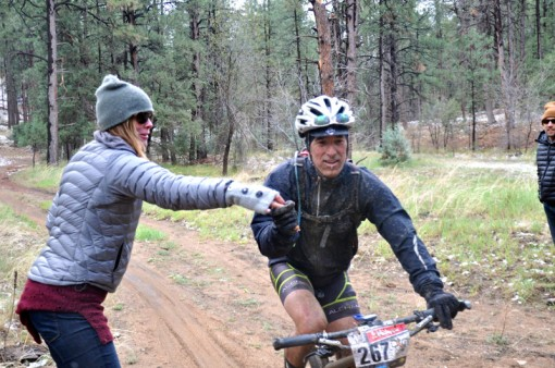 Cold, rain, mud, flat tires, and muddy snot couldn't stop the Bliss train from delivering.  Here is John getting a hand up from one of the intrepid volunteers.