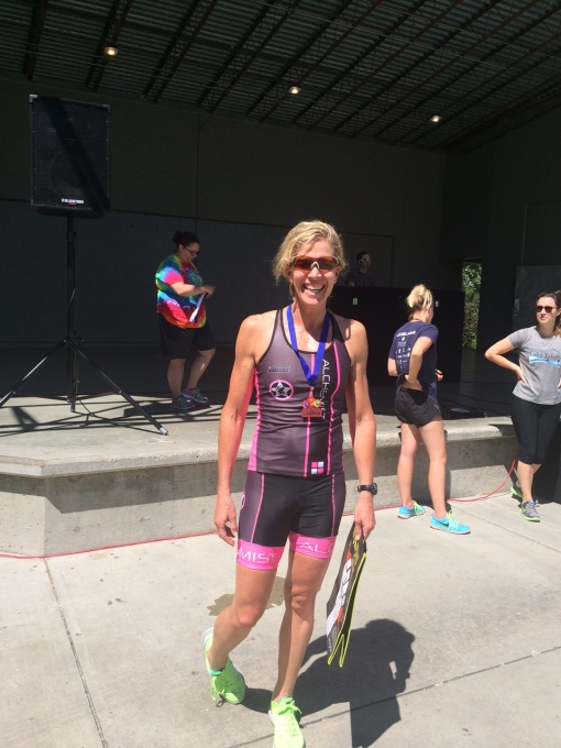 Emily strutting away with her first place Aquabike (swim,bike) medal.   Big ups, Emily!